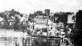 端午节上海半淞园湖中龙舟竞渡的盛况